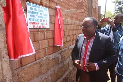 Tharaka Nithi's able Governor Samuel Rangwa launches an incomplete dormitory. Photo: Courtesy