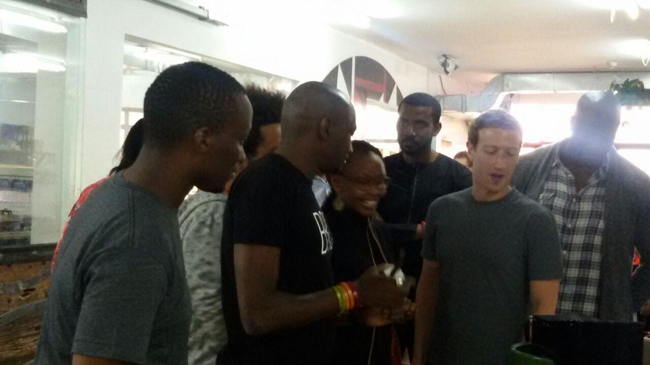 Mark Zuckerberg at Mama Oliech's - Nairobi eating fish 3