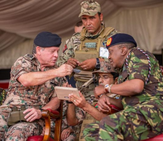 Uhuru Kenyatta with Majesty King Abdullah II of Jordan witnessing a joint military training exercise between the Kenya Defence Forces and the Royal Jordanian Armed Forces at Embakasi Garrison