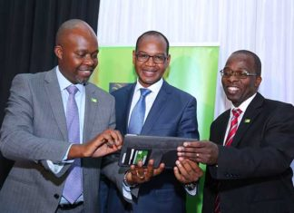 From Left) KCB Group CFO Lawrence Kimathi , KCB Group CEO and MD Joshua Oigara and KCB Group COO Sam Makome during the announcement of the KCB Group Q3 financial results