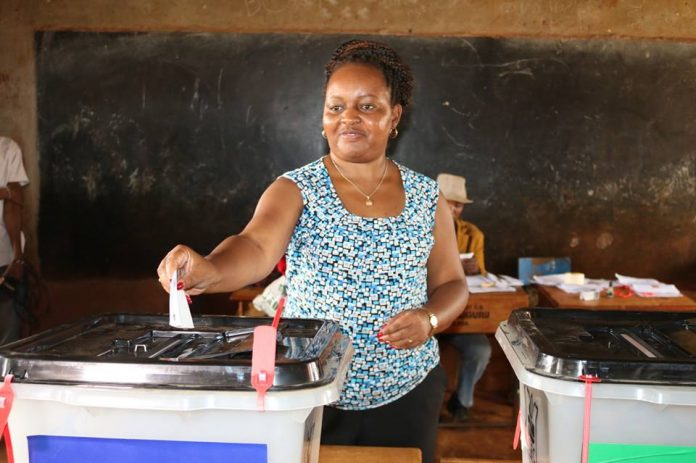 Ann mumbi waiguru casting her vote in Kirinyaga, where she has won comfortably