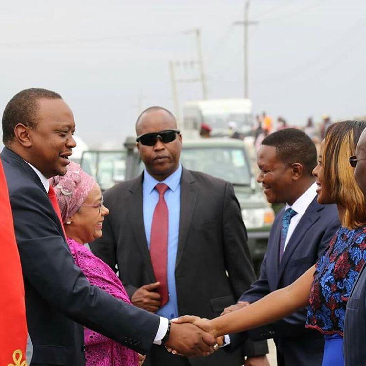 Uhuru Kenyatta and Governor Mutua's wife Lilian Nganga Handshake
