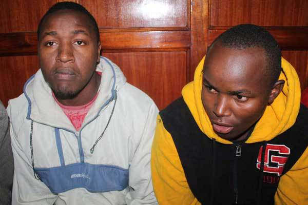 Nicholas Chege Mwangi (left) and Meshack Chege Mwangi in a Nairobi court. They are among three men sentenced to death for stripping and robbing a female passenger in a Githurai-bound bus three years ago