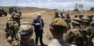 Britain's Foreign Secretary Boris Johnson talks to British soldiers at the British Army Training Unit Kenya (BATUK), in Ole Naishu near Nanyuki, in Kenya