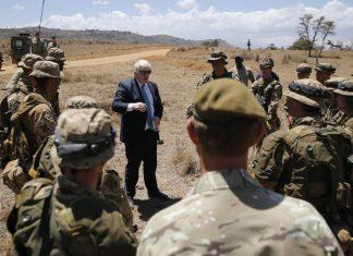 Britain's Foreign Secretary Boris Johnson talks to British soldiers at the British Army Training Unit Kenya (BATUK), in Ole Naishu near Nanyuki, in Kenya